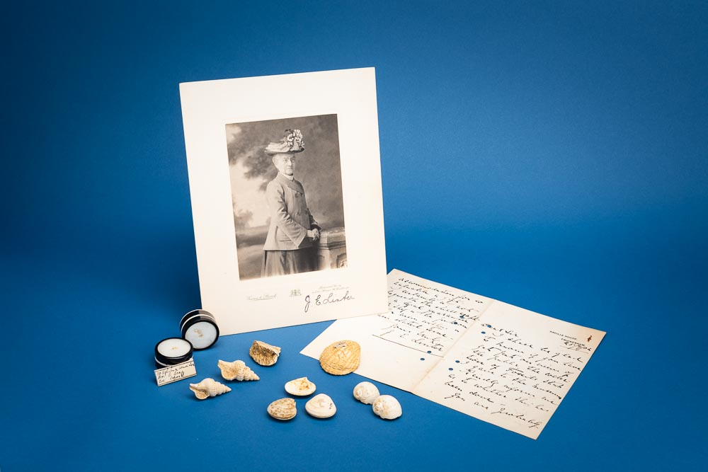 Photo of Miss Linter with shells and a letter