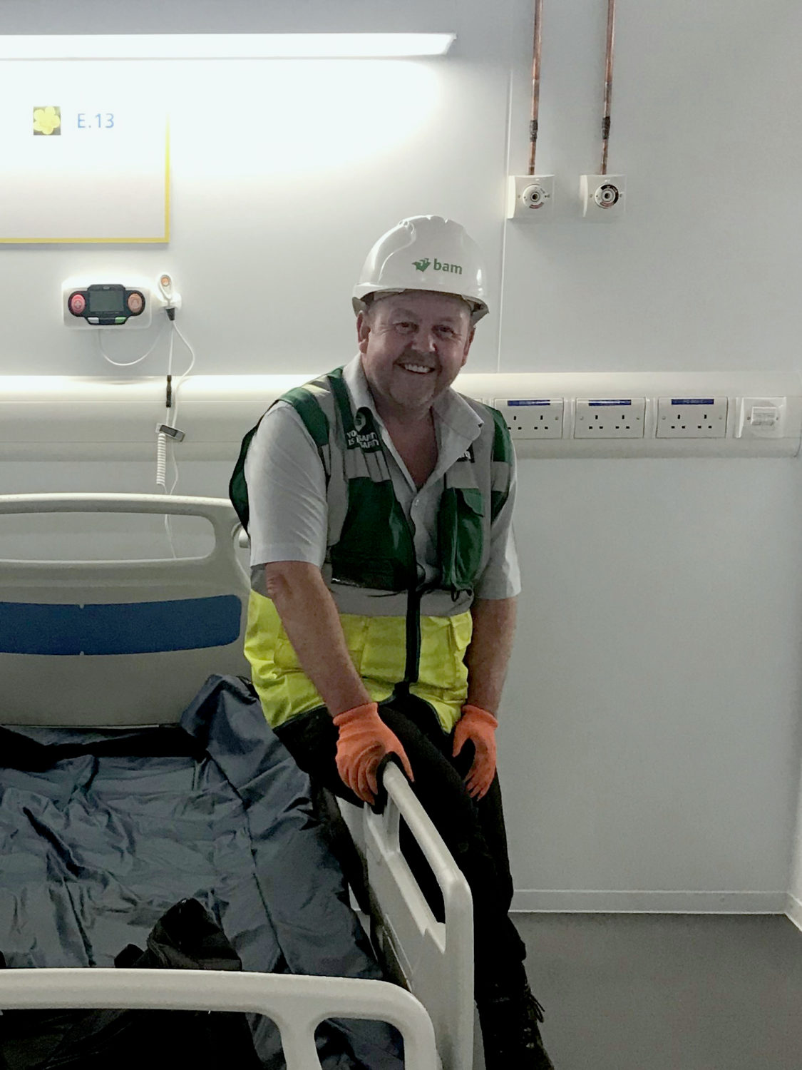 Andy Witnall wearing construction PPE in a hospital