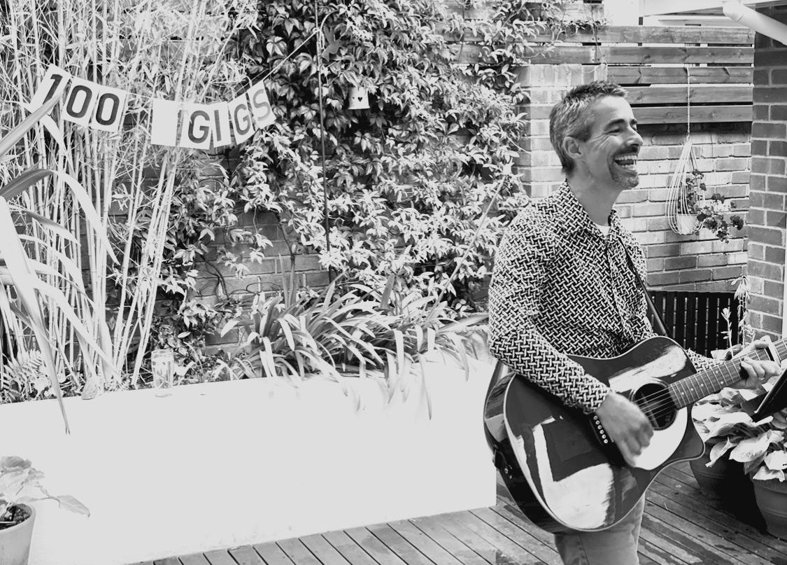 Ashley Leeds playing a guitar