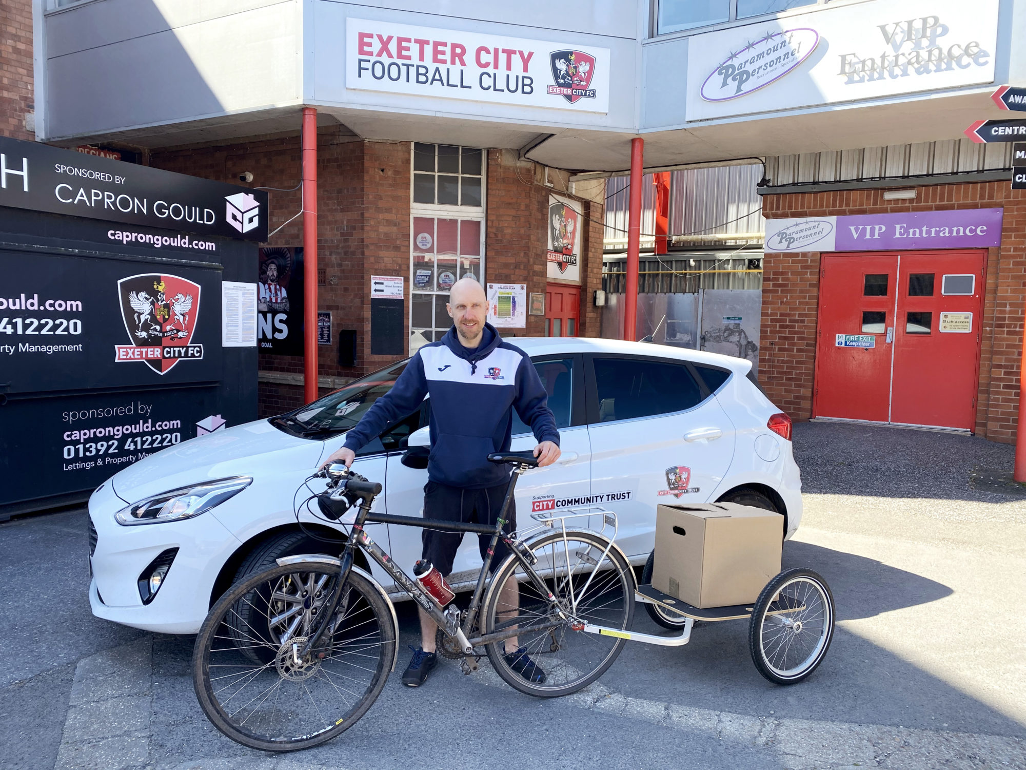 Andy O'Doherty outside Exeter City Football Club with his delivery bike