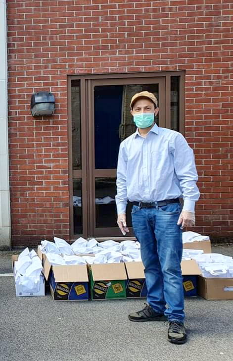 Jakir Hussain with boxes of supplies