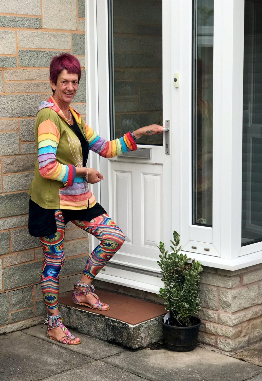 Jan Roberts opening a house door