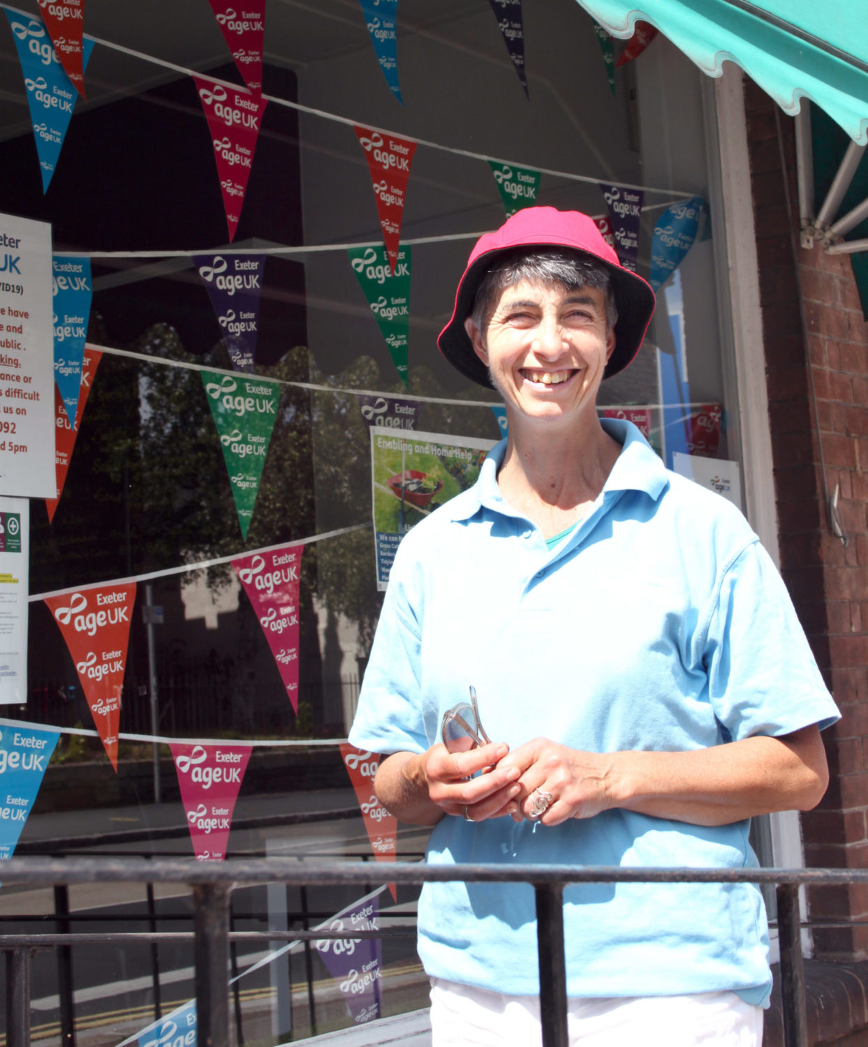 Jess Cohen outside a building with bunting flying