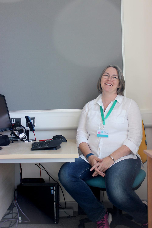 Joanna Fison sat at a desk