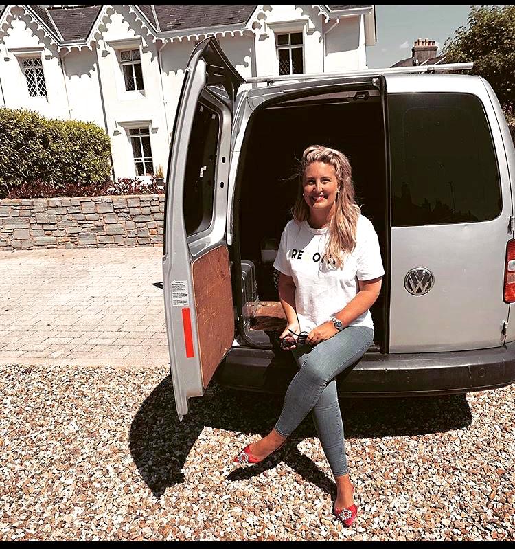 Katie sat in a van with an open door