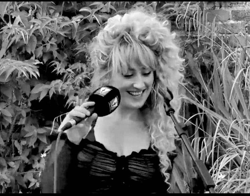 Livvy Hylton holding a microphone
