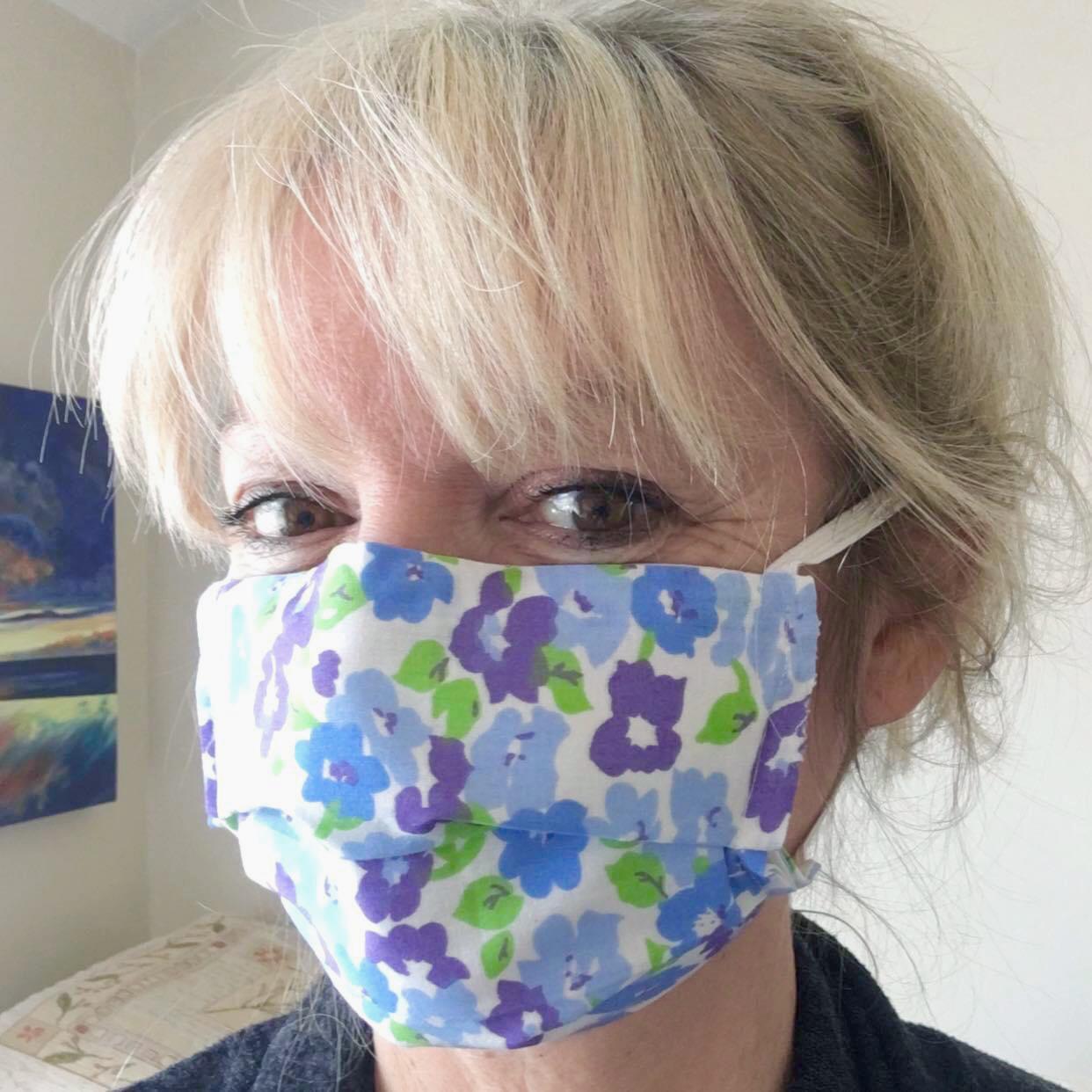 Liz, wearing a patterned mask