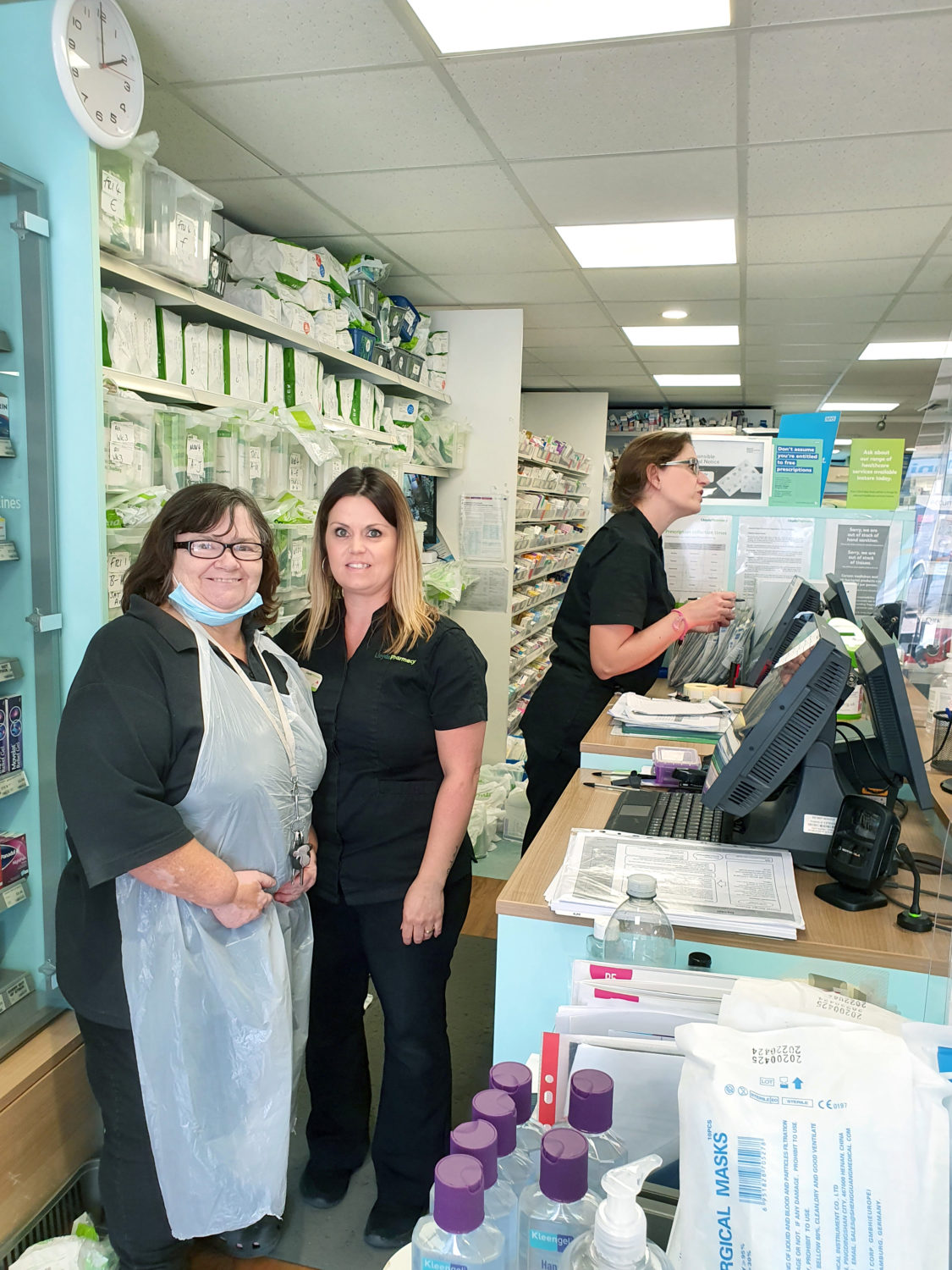 Staff in the shop at Lloyds Pharmacy, Heavitree