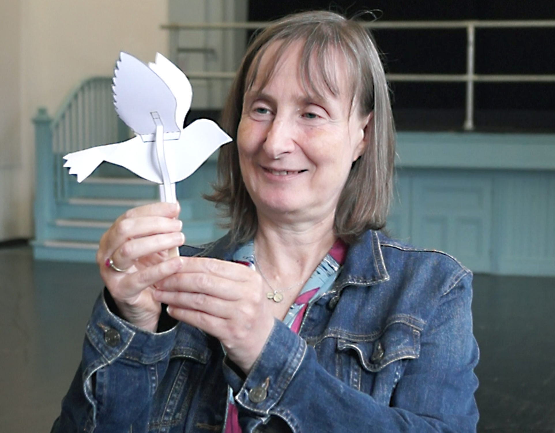 Nikki Sved with a paper bird