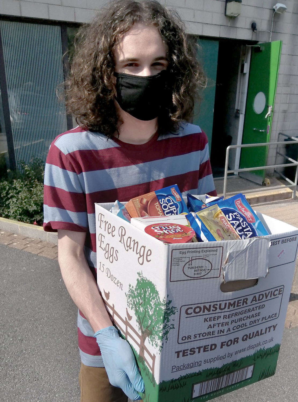 Sammy Hartstein holding a box of food