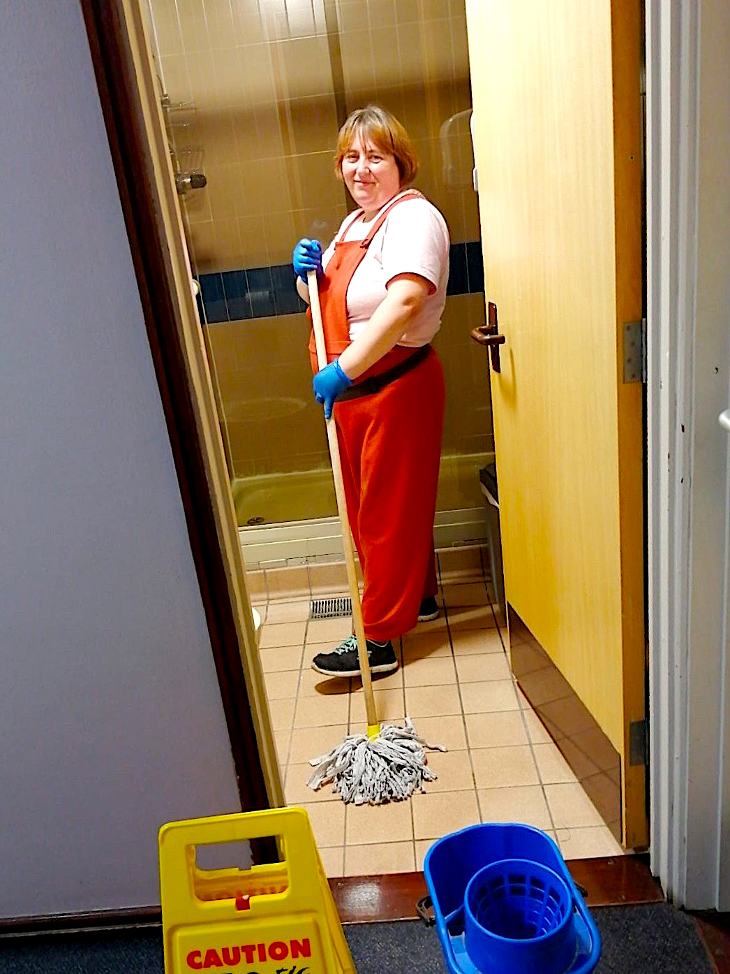 Sarah Griffiths cleaning with a mop