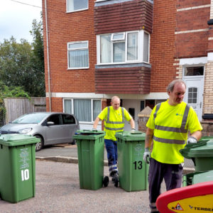 Jason Keith with wheelie bins and a colleague collecting rubbish